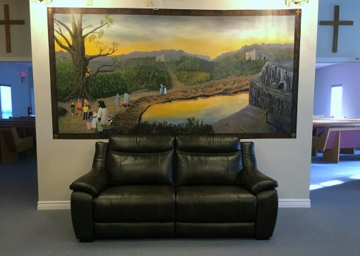 New Couch Two in lobby in front of mural