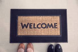 welcome mat with two pairs of shoes